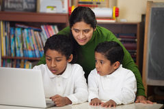Hispanic Family with Laptop in Home-school Setting Stock Photo