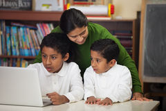Hispanic Family with Laptop in Home-school Setting Stock Image
