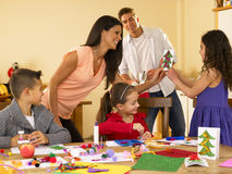 Hispanic family making Christmas cards Stock Image