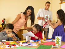 Hispanic family making Christmas cards. At home Royalty Free Stock Photography