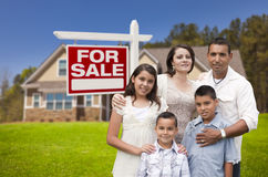 Hispanic Family, New Home and For Sale Real Estate Sign Stock Photography
