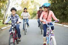 Hispanic Family On Cycle Ride In Countryside Stock Photo