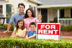 Hispanic family outside home for rent royalty free stock photography
