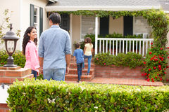 Hispanic family outside home for rent royalty free stock image