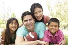 Hispanic Family In Park With Soccer Ball Royalty Free Stock Images