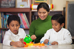 Hispanic Family Playing Mr. Frog Stock Photos