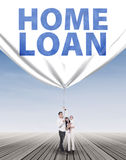 Hispanic family pulling a home loan banner Stock Images