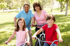 Hispanic family riding bikes in park Royalty Free Stock Photos