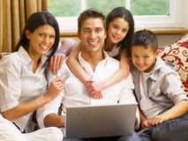 Hispanic family shopping online. At home stock images