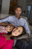 Hispanic Family Sitting On Sofa And Watching TV Royalty Free Stock Images
