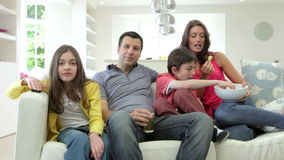 Hispanic Family Sitting On Sofa Watching TV Together stock video footage