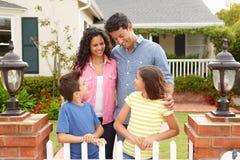 Hispanic family standing outside home Stock Photography