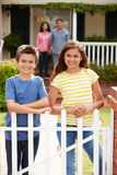 Hispanic family standing outside home Stock Image