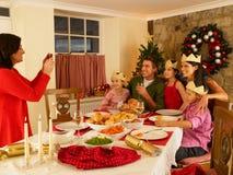 Hispanic family taking photos of Christmas dinner royalty free stock images