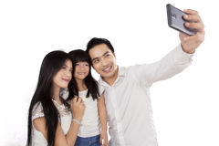 Hispanic family taking self portrait Royalty Free Stock Photography