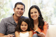 Hispanic family watching television Stock Images