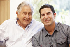 Hispanic father and adult son Stock Photo