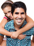 Hispanic father carrying her daughter Stock Photos
