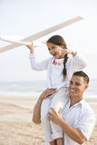 Hispanic father and daughter having fun on beach Stock Photography