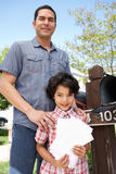 Hispanic Father And Son Checking Mailbox Royalty Free Stock Photos