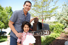 Hispanic Father And Son Checking Mailbox Royalty Free Stock Images