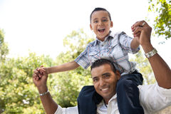 Hispanic Father and Son Having Fun in the Park Stock Photography