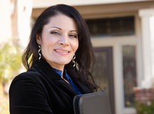 Hispanic Female Business Woman in Front of House Stock Photography