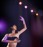 Hispanic female dancer on disco background Stock Photo