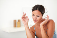 Hispanic female dancing to the music Stock Images