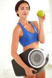 Hispanic female dieting on fruit and exercise Stock Image