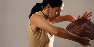 Hispanic female with fan Royalty Free Stock Images