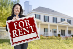 Hispanic Female Holding For Rent Sign In Front of House Royalty Free Stock Images