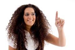 Hispanic female pointing upwards Royalty Free Stock Image