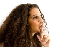 Hispanic female shushing with finger Royalty Free Stock Photos