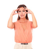Hispanic female suffering from migraine headache Stock Photography