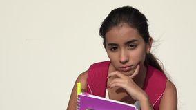 Hispanic Female Teen Student Thinking. A young female hispanic teen stock video footage