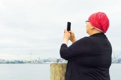 Hispanic Female Uses Cell Phone Stock Image