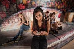 Hispanic Female Using Phone Royalty Free Stock Photos