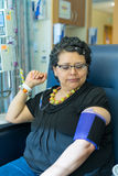 Hispanic Female Waits Pateintly During Chemo Treatment Infusion Stock Images