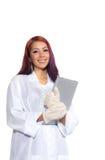 Hispanic Female Wearing Lab Coat While Holding Clipboard Stock Images