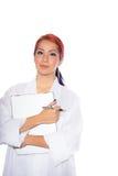 Hispanic Female Wearing Lab Coat While Holding Clipboard Stock Photo