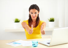 Hispanic female working as a boss Royalty Free Stock Images