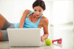 Hispanic fit woman browsing the web Stock Photography