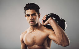 Hispanic fitness male model holding kettle bell Stock Images