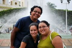 Hispanic friends. Beautiful HIspanic women and man together standing in front of a fountain in Tapachula, Mexico Royalty Free Stock Photos