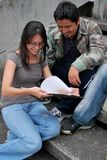 Hispanic friends studying together. Hispanic students studying together on the steps of a college campus Royalty Free Stock Photo