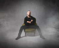 Hispanic gang member sitting on chair Stock Images
