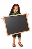 Hispanic Girl with Blank Blackboard. Beautiful three year old hispanic girl with blank chalkboard over white Royalty Free Stock Photos