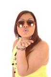 Hispanic girl blowing kiss. Stock Photos