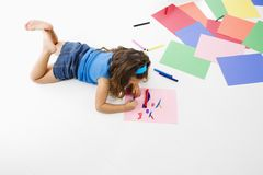 Hispanic girl coloring. Stock Image